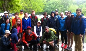 Bliss and Ally Taylor leading students and adults on Hike2Help trek in pouring rain